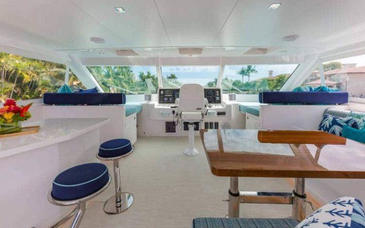 MUCHO GUSTO power catamaran yacht charter flybridge